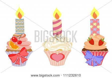 Set of cakes with birthday candles.