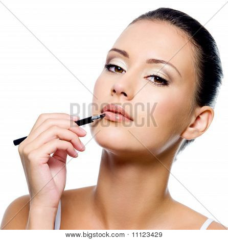 Beauty Woman Applying Lipstick