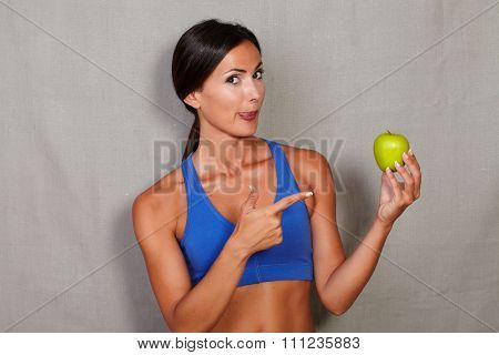 Woman Licking His Lips And Pointing To Apple