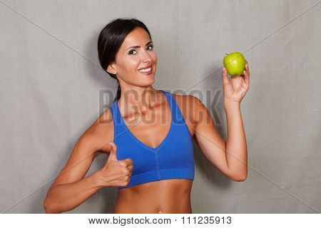 Happy Lady With Thumb Up Showing Apple