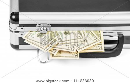 Dollar bills sticking out of suitcase