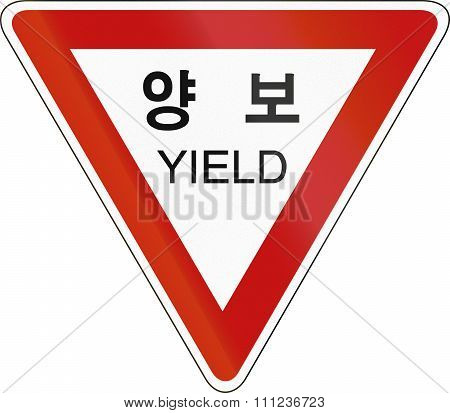 Korea Traffic Safety Sign With The Word Yield In English And Korean Script