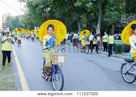 Girl In Traditional Dress Holding Umbrella Riding The Bicycle Around Chiang Mai City In