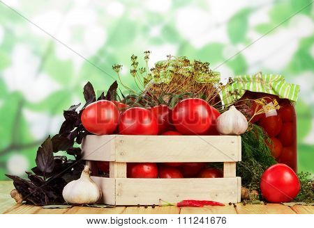 Tomatoes with garlic on table
