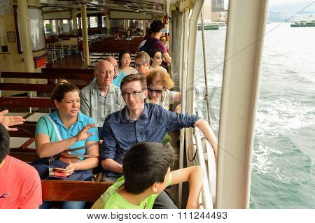 HONG KONG - MAY 06, 2015: passenger on upper deck of a Star Ferry. The Star Ferry is a passenger ferry service operator and tourist attraction in Hong Kong