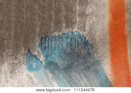 Close Up Of Scratched Metal Surface With Colored Parts