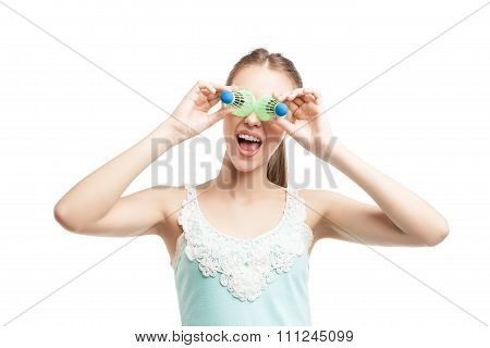 Sport woman with shuttlecocks near her eyes