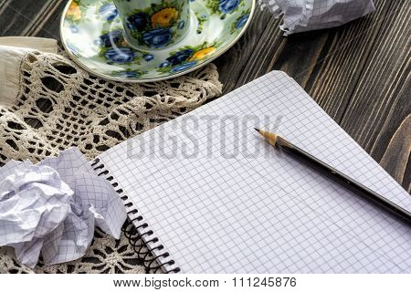 White Note Pad And Pencil On Table