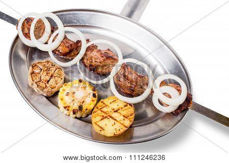Traditional beef shish kebab on skewers.