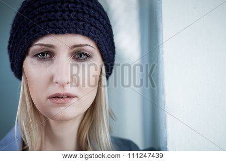 Depressed blond female druggie is weeping for loneliness