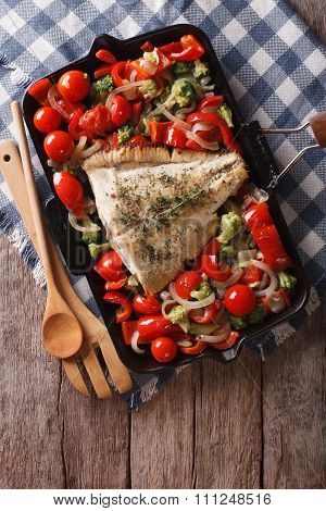 Flounder With Vegetables On A Frying Pan. Vertical Top View