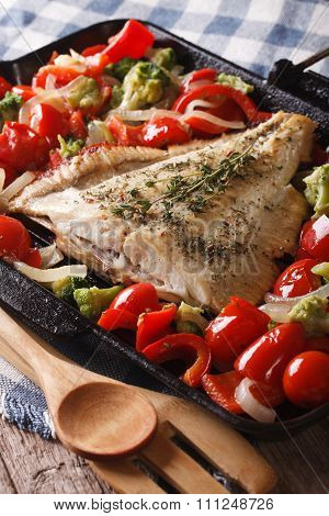 Homemade Flatfish With Vegetables Close-up In A Pan. Vertical