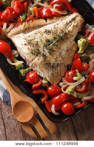 Tasty Flounder With Vegetables Close-up In A Pan. Vertical Top View