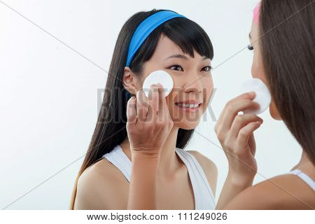 Pretty two girls are caring of their skin