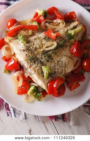 Baked Flounder With Vegetables Close-up On A Plate. Vertical Top View