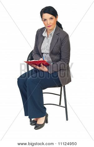 Business Woman On Chair Taking Notes