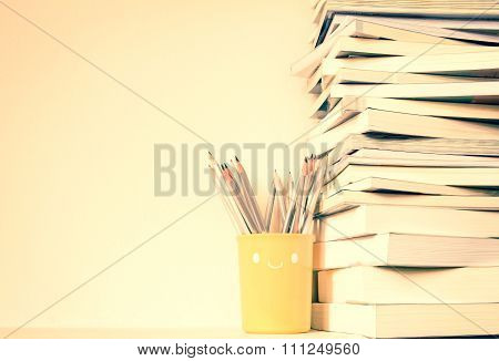 Vintage Color Tone Of Close Up Book Stacked  With Concrete Wall Background