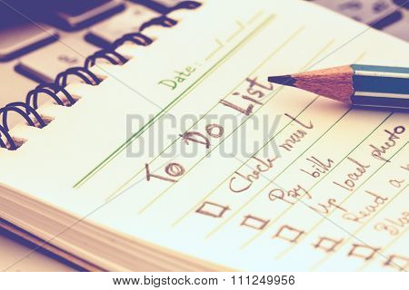 Selective Focus On Handwritten To Do List Plan In Small Note Book , Vintage Style