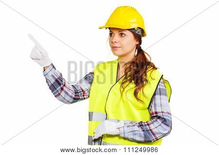 Young Woman In Construction Helmet And Yellow Shirt
