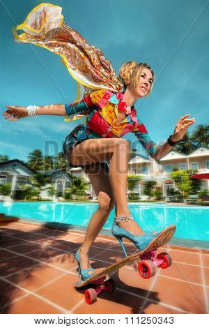 Glamour Model with Skateboard having fun at pool party, enjoy her summer vacation