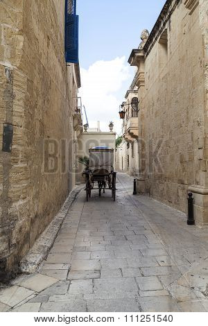 Typical Narrow Street With Cab  In The Medieval Town Mdina, Malta