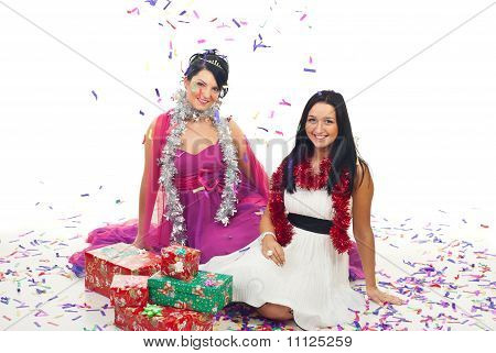 Christmas Women At Party  With Confetti And Gifts