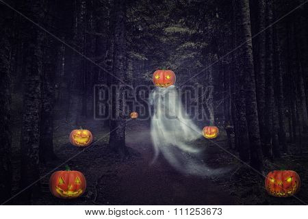 Helloween ghost with pumpkins in the night forest