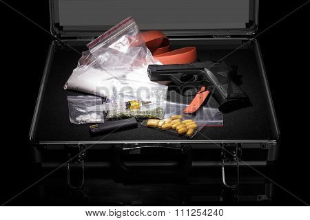Case with  gun and drugs
