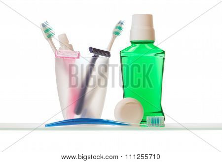 Toothpaste and toothbrushes on shelf
