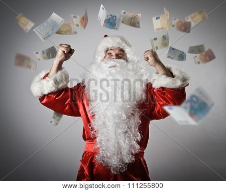 Santa Claus And Euro. Santa Claus With His Hands Up.