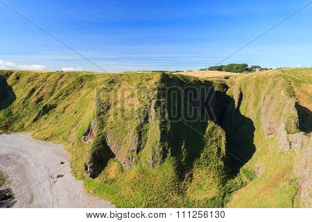 Beautiful Landscape Of Hill And Rock At Dunnottar Castle Area, Aberdeen Scotland, Uk