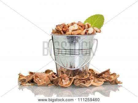 Nuts in metal bucket