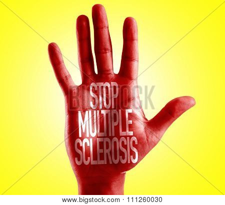 Stop Multiple Sclerosis written on hand with yellow background