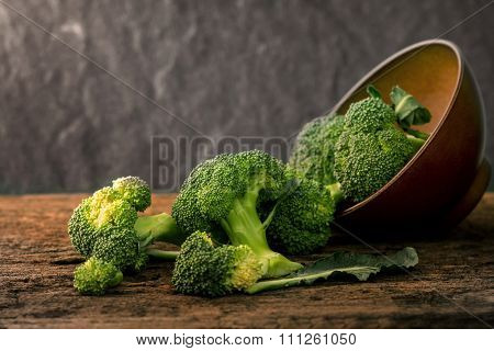 Selective Focus  Fresh Green Broccoli On Wooden Plate