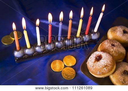 Hanukkah Table With Donuts And Candles