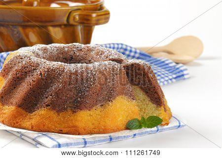 detail of marble bundt cake and bundt cake pan