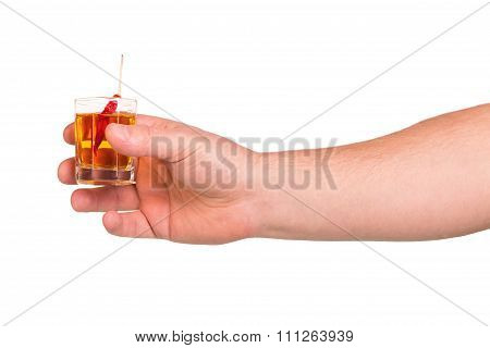 Glass of alcohol beverage in hand