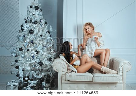 Girls Comfort Of Your Home Sitting Couch And Talk.