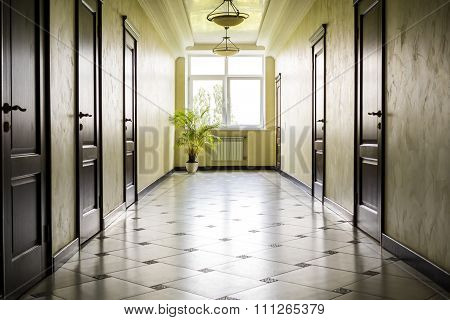 Kiev Ukraine - July 6 2015: White Hallway With Marble Floor, Brown Doors And Window In Hospital