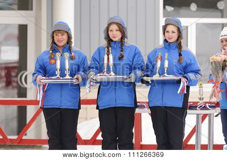 SYKTYVKAR, RUSSIA - APRIL 02, 2013: girls hold prizes during the Russian cross-country ski championship-2013. It had been run by Cross-country ski Federation of Russia in Syktyvkar.