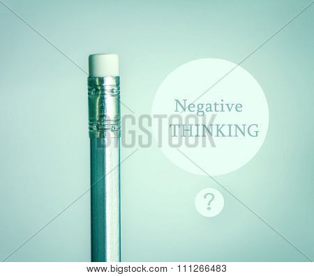 Close Up Eraser On Top Silver Pencil On Blue Gray Gradient Background With Negative Thinking Concept