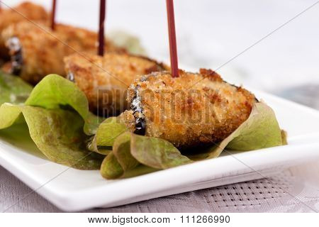 eggplant appetizer on white plate