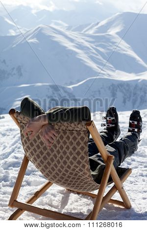 Skier At Winter Mountains Resting On Sun-lounger