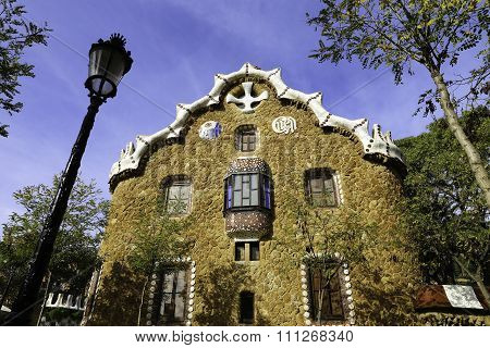 Facade View Of Gingerbread House Of Architect Gaudi In Park Guell In A Sunny Barcelona Day Spain