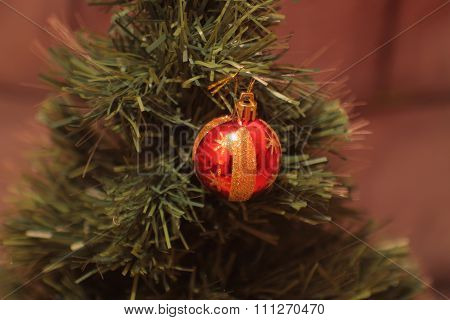Christmas ball on the pinetree.