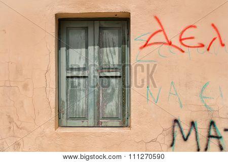 Window with a Green Shutter