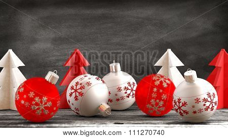 Christmas ornaments on a wooden table with a blackboard background.