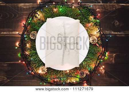 Golden Gift On The Plate In Wreath
