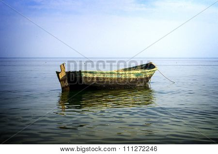 Boat At Anchor In Sea High Contrasted With Vignetting Effect