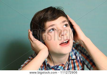 Boy With Headphones Listen To Popular Music